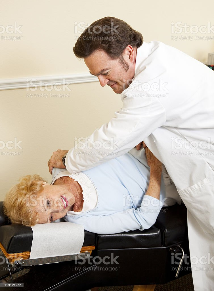 Patient Enjoys Chiropractic Care royalty-free stock photo