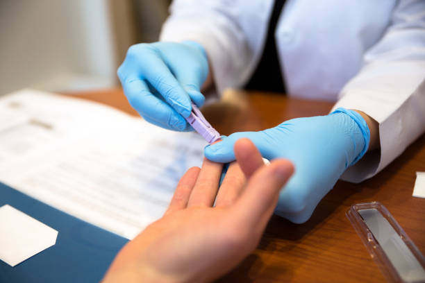 Patient getting a blood test from a doctor Doctor tests a patient for HIV AIDS. hiv stock pictures, royalty-free photos & images