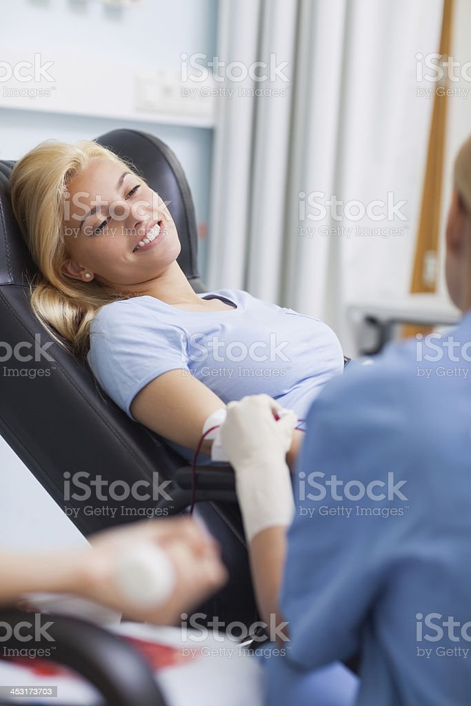 Patient giving her blood stock photo