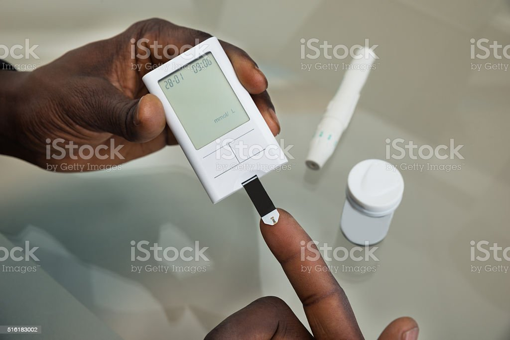 Patient Hands With Glucometer stock photo