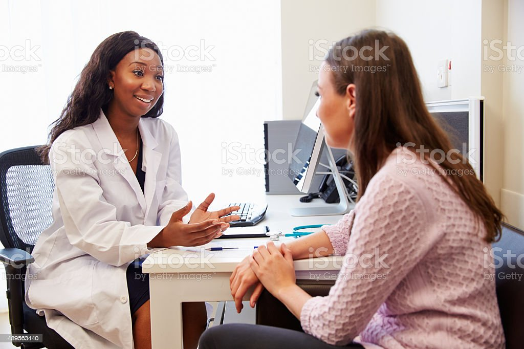 Patient Having Consultation With Female Doctor In Office - Royalty-free 20-29 Years Stock Photo