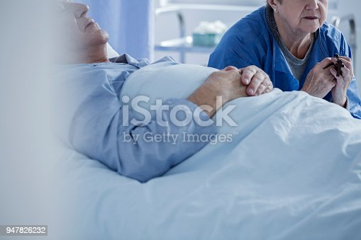909569706istockphoto Patient in a coma and wife 947826232