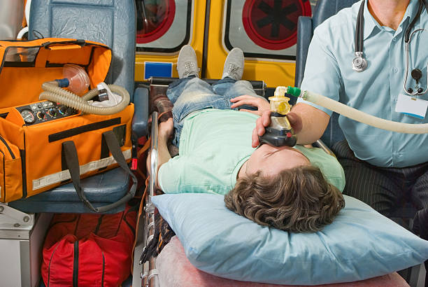 patient in ambulance - emergency response stock pictures, royalty-free photos & images