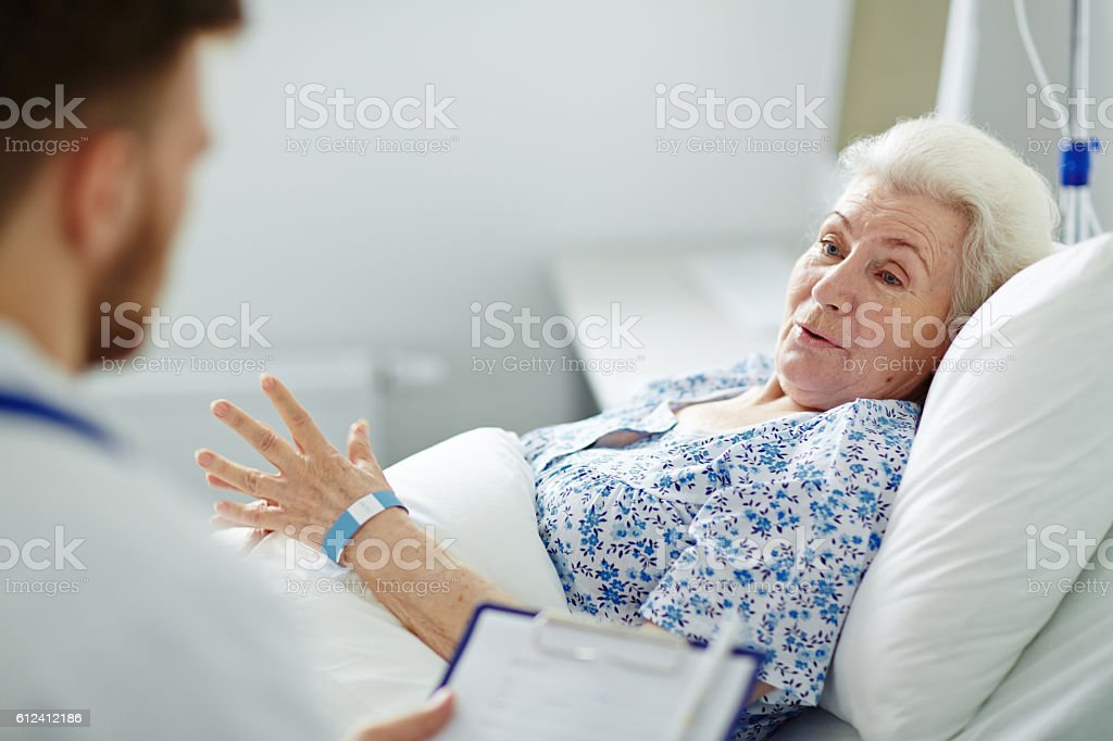 Patient in bed stock photo