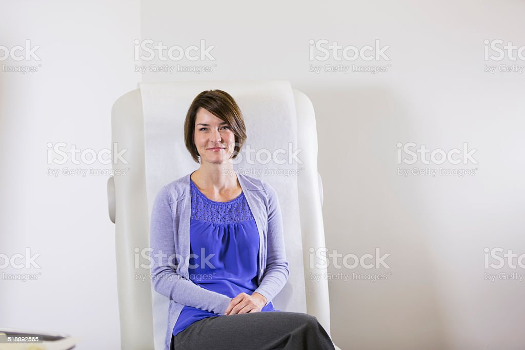 Patient in doctor's office stock photo