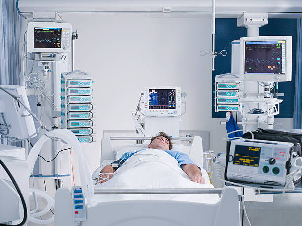 Patient in intensive care  life support machine stock pictures, royalty-free photos & images