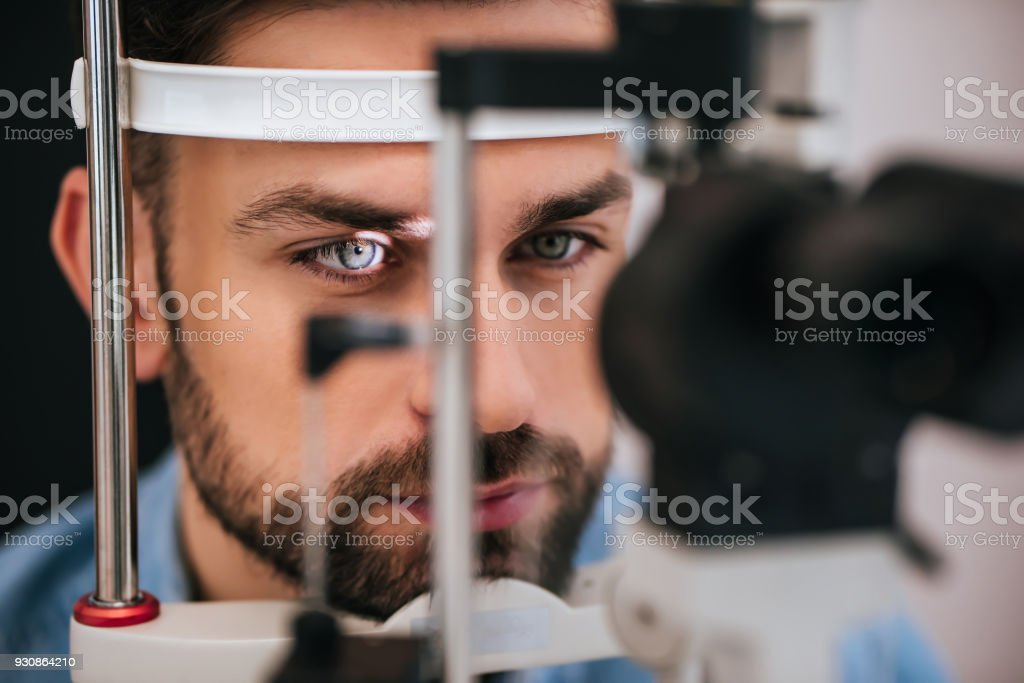 Patient in ophthalmology clinic stock photo