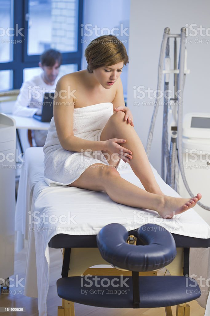Patient  Looking at Problem Hair on Her Legs stock photo