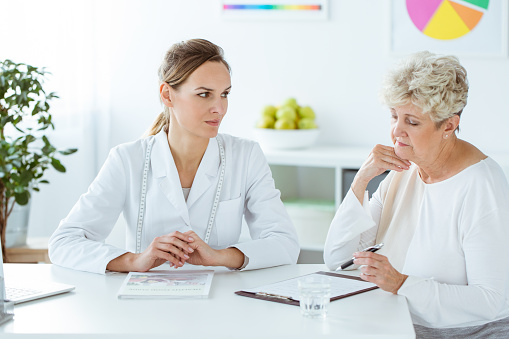 istock Patient looking at the results 919825900