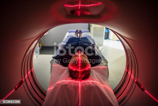 istock Patient lying inside a medical scanner in hospital 503663386