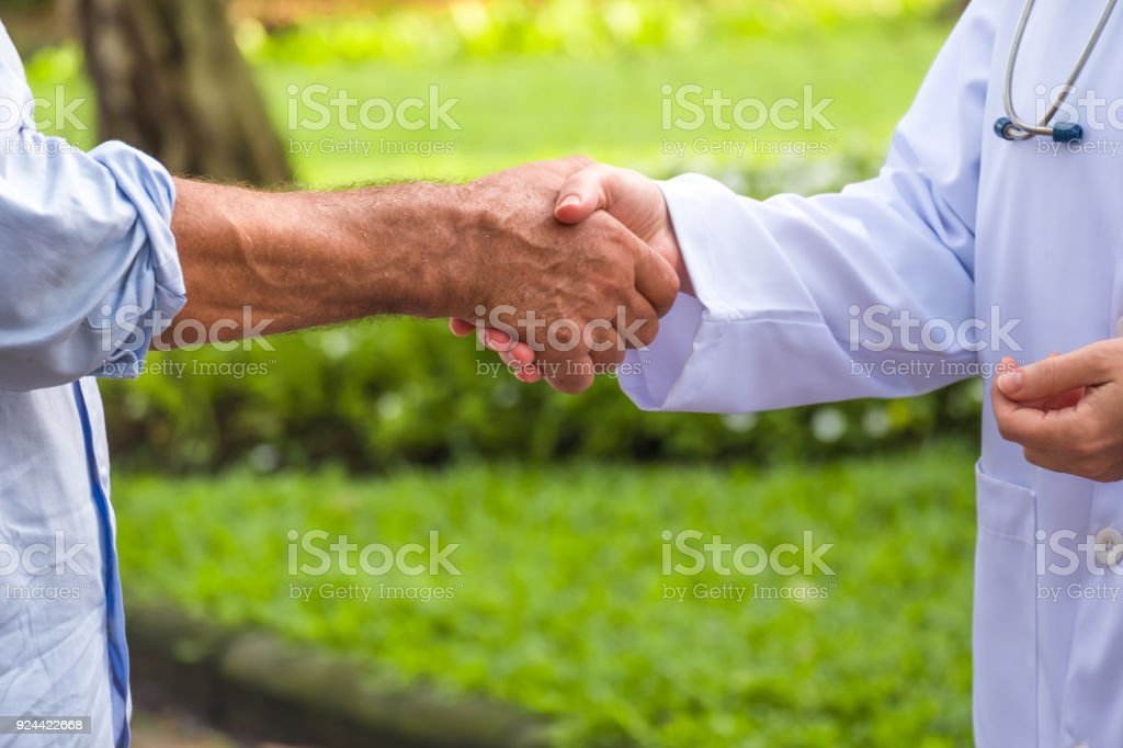 Patient Man Handshake To Thank You The Doctor For Help To