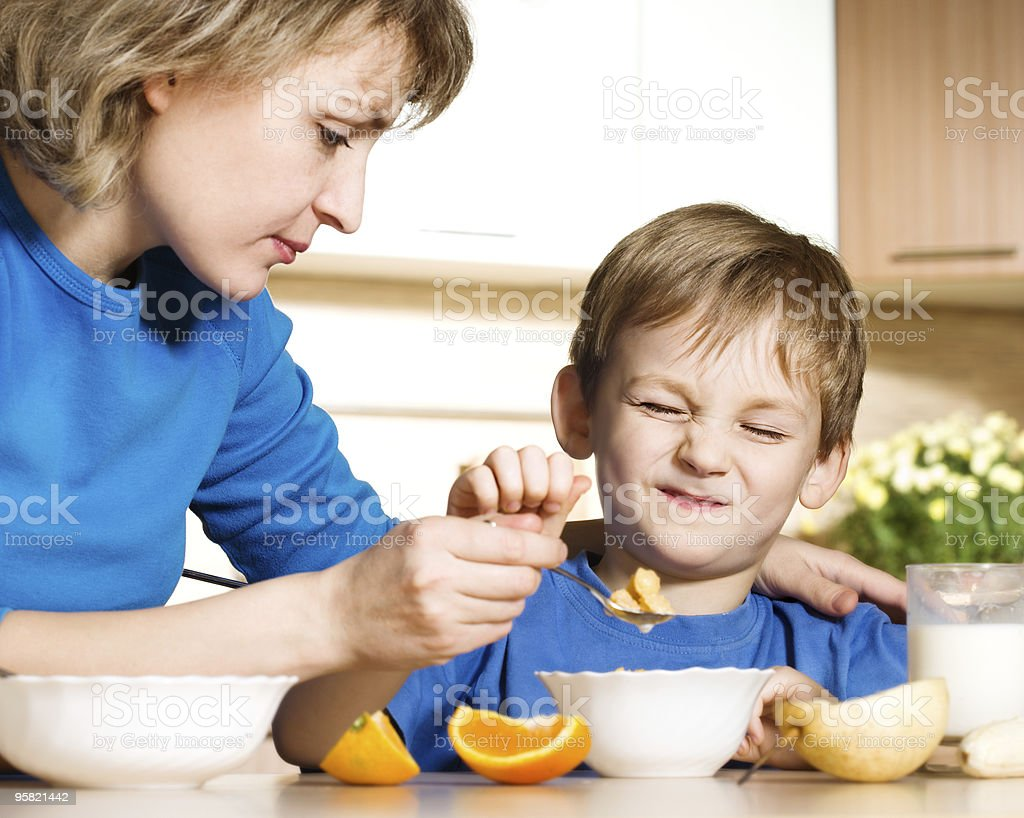 Patient mother and naughty son royalty-free stock photo