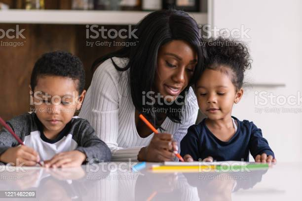 A Patient Mother Homeschool During A Pandemic Stock Photo - Download Image Now