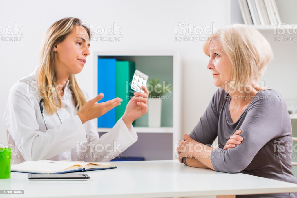 Patient rejecting taking pills stock photo
