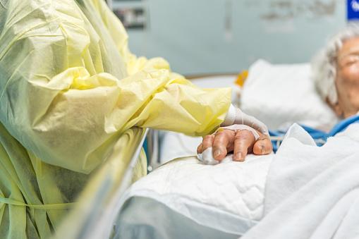 istock Patient relative taking care of the elder patient 978255204