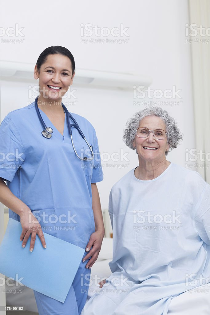Patient sitting on a bed royalty-free stock photo
