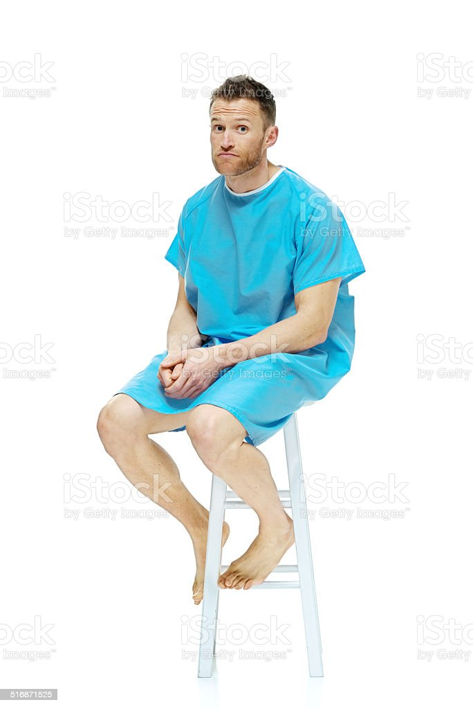 Patient sitting on stool looking at camera stock photo