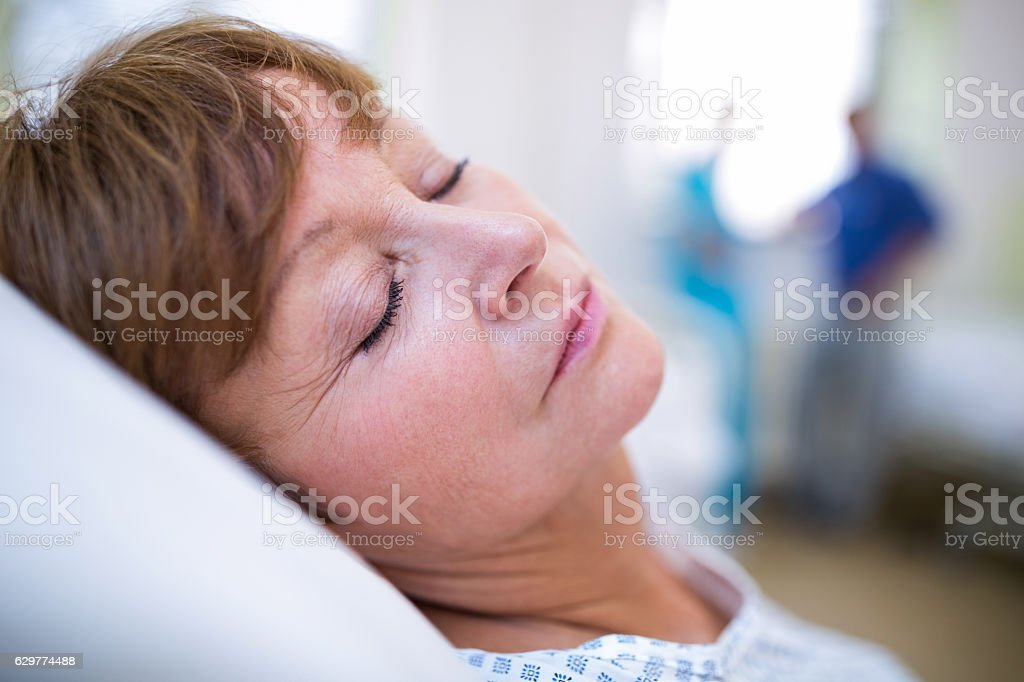 Patient sleeping on bed stock photo