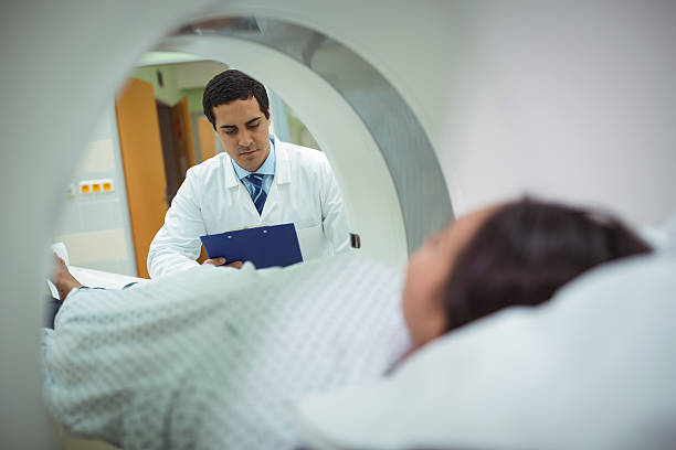 Patient undergoing CT scan test stock photo