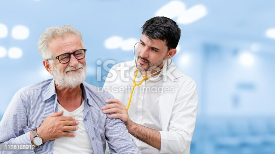 1064843136istockphoto Patient visits doctor at the hospital. Concept of medical healthcare and doctor staff service. 1128168912