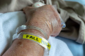 A patient wearing a fall risk bracelet in hotspital.(selective focus)