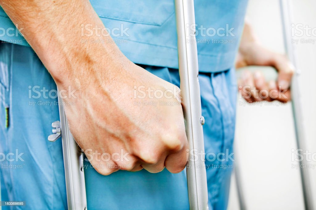 Patient with crutches stock photo