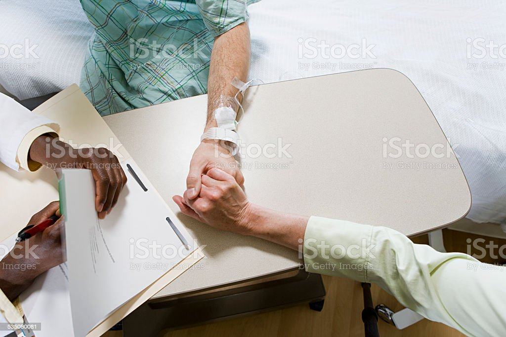 Patient with doctor and relative stock photo