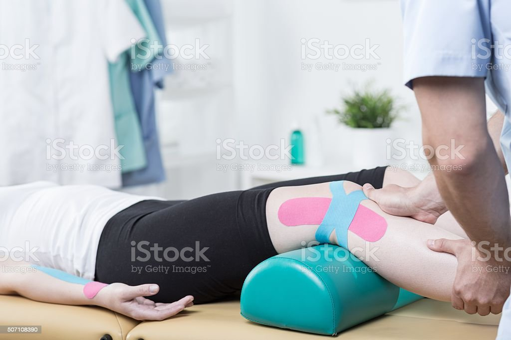 Patient with elastic therapeutic tape stock photo