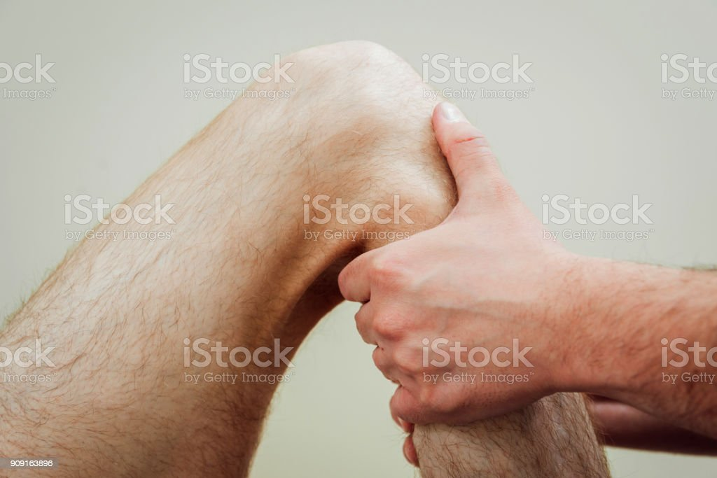 Patient with orthopedist doctor in his office. stock photo