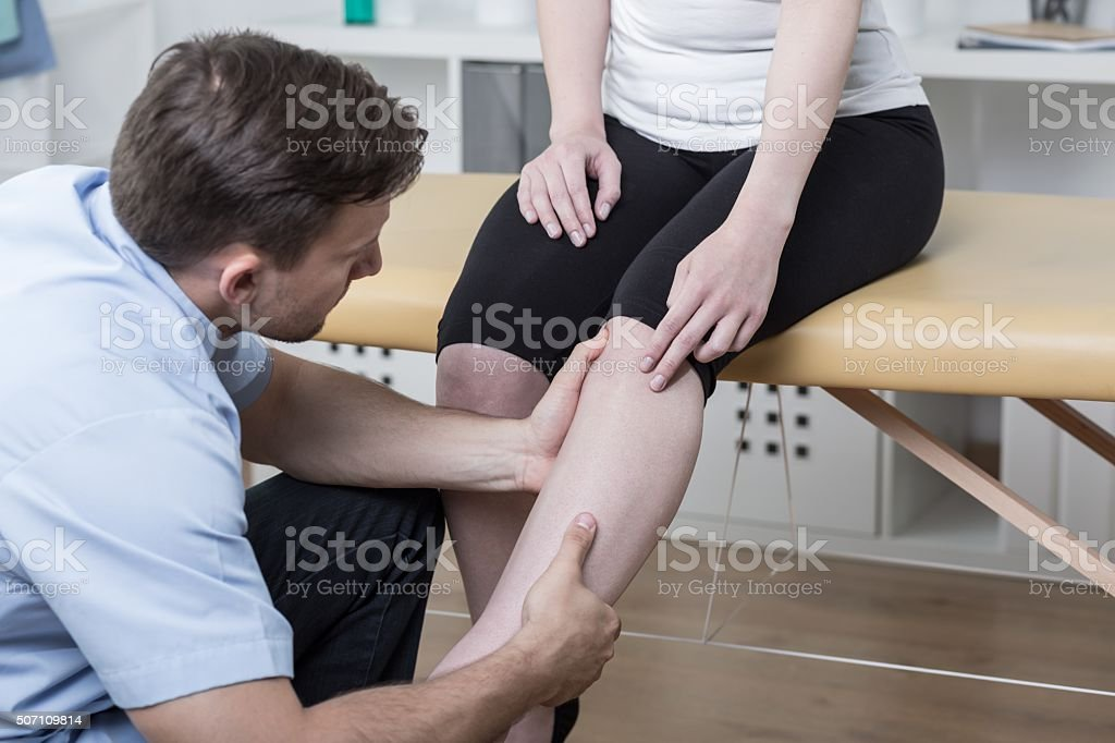 Patient with painful knee stock photo