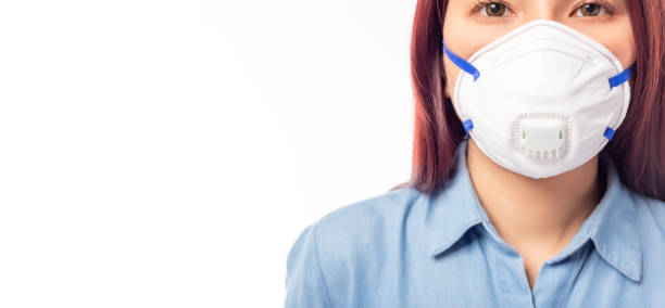 Patient woman wearing face mask for prevent spread virus to people who will infect flu, viruses, coronavirus or covid 19. Face Mask prevent from corona virus, air pollution and pm 2.5 also. copy space stock photo