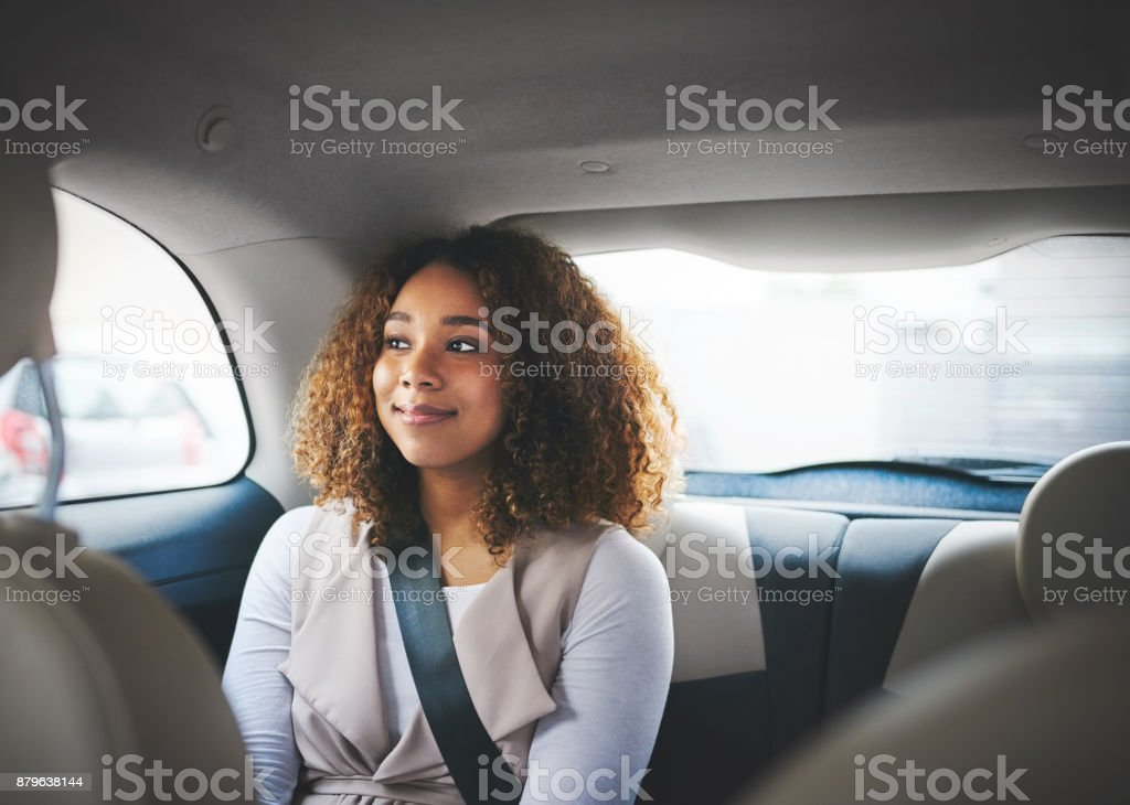 Patiently waiting to get to her destination stock photo