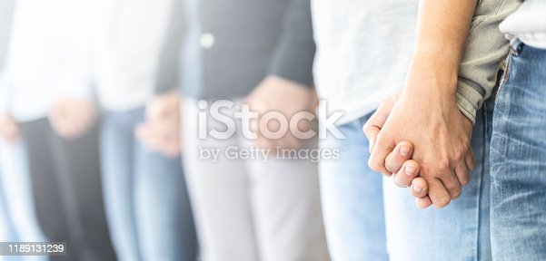 1016771914 istock photo Patients on group therapy are holding hands. 1189131239