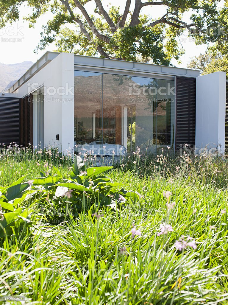 Patio and garden in rear of modern home royalty-free stock photo