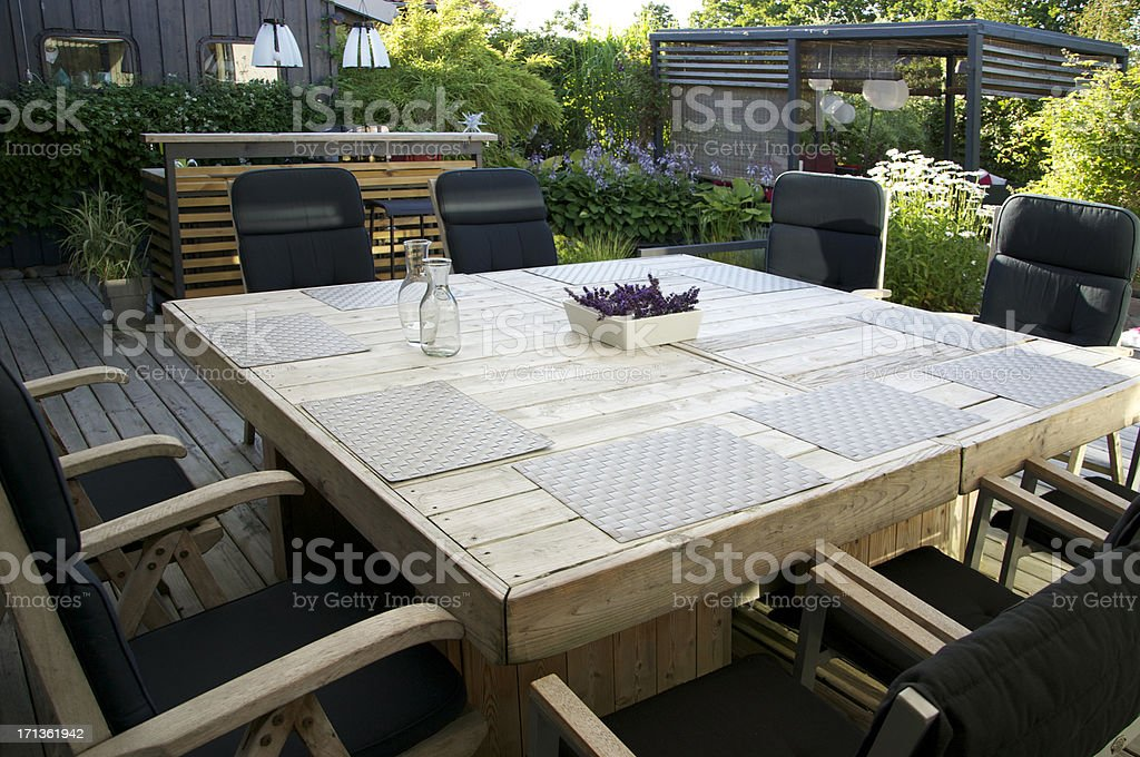 Patio and outdoor living space, with dining table royalty-free stock photo