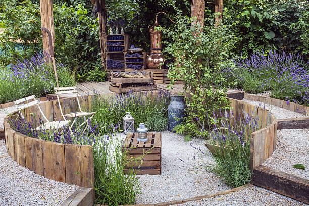 patio area in a garden - paletten terrasse stock-fotos und bilder