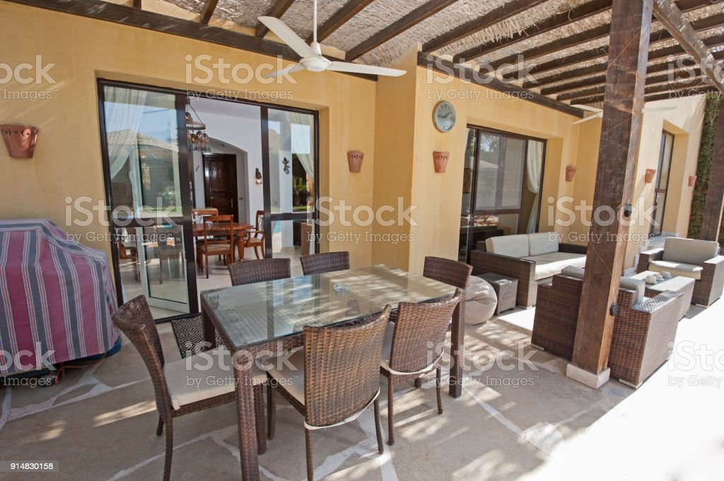 Luxury villa show home in tropical summer holiday resort with patio...