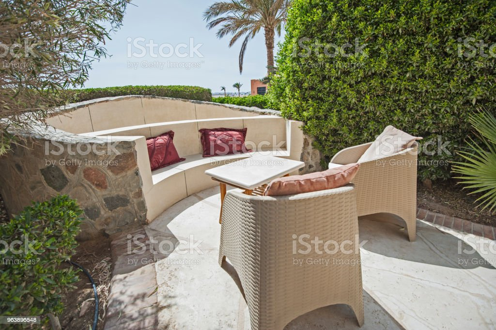 Patio area with sofa seating area at a luxury tropical holiday villa resort - Royalty-free Architecture Stock Photo