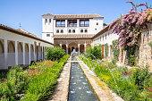 Garden and fountain in patio de la Acequia La Alhambra, Granada, Andalucia, Spain