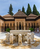 Granada, Spain - September 9, 2016: groups of tourists taking pictures in Patio de los leones. Alhambra of Granada, Spain. Alhambra of Granada is one of the most known and visited monuments in Spain.