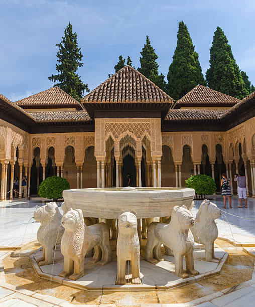 Patio de los leones in alhambra granada Granada, Spain - September 9, 2016: groups of tourists taking pictures in Patio de los leones. Alhambra of Granada, Spain. Alhambra of Granada is one of the most known and visited monuments in Spain. palacios nazaries stock pictures, royalty-free photos & images