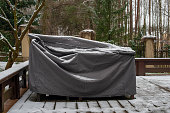 istock Patio furniture Cover protecting outdoor furniture from snow. 1294474236
