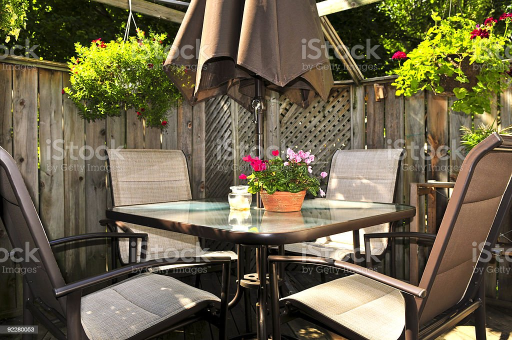 Patio furniture on a deck stock photo
