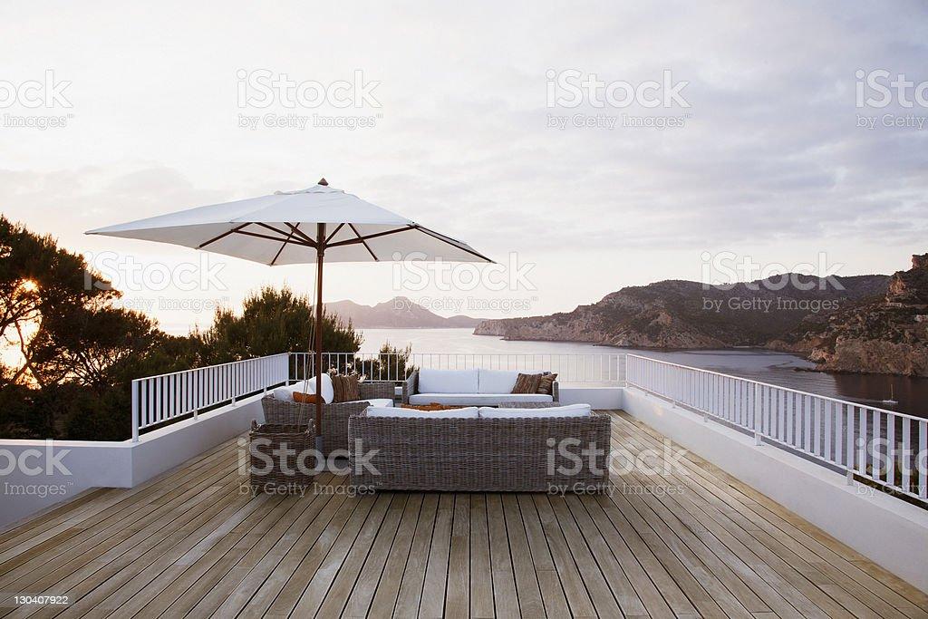 Patio furniture on modern deck stock photo