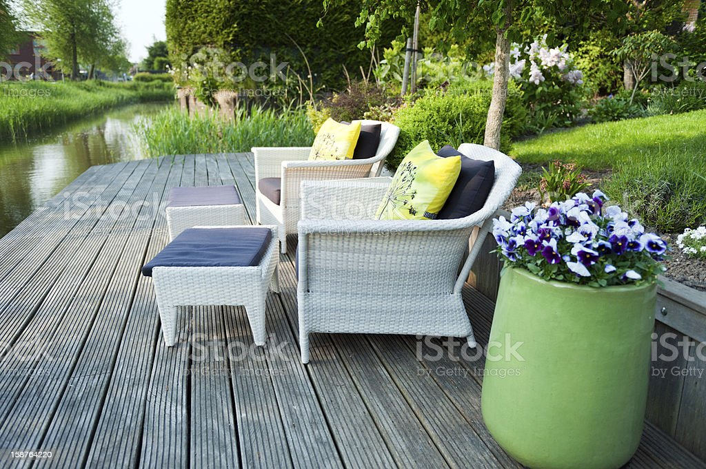 Wicker patio furniture on a wooden deck.