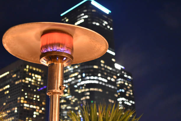 patio heater with skyscraper - steven harrie stock photos and pictures