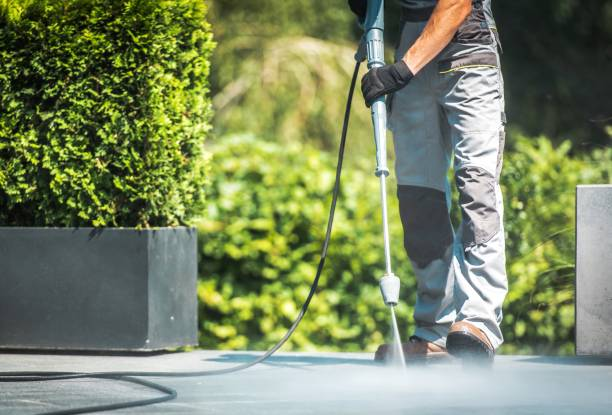 Patio Pressure Cleaning Patio Pressure Cleaning. Caucasian Men Washing His Concrete Floor Patio Using High Pressured Water Cleaner. grounds stock pictures, royalty-free photos & images