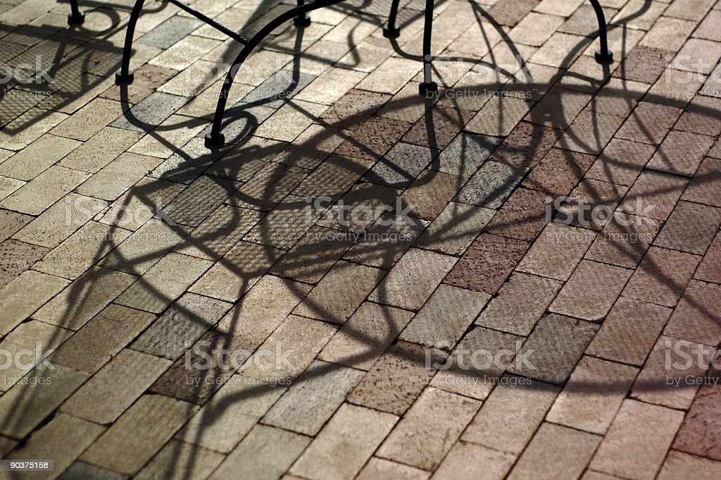 patio table and chair shadow abstract royalty-free stock photo