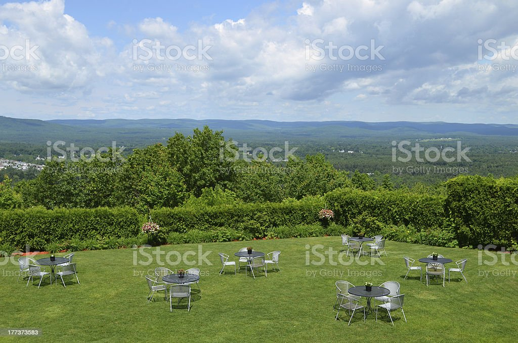 Patio tables and chairs in a private garden area stock photo