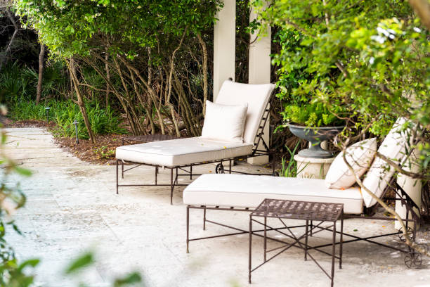 Patio two lounge chairs in outdoor spring green garden in backyard porch of home zen, plants, reclining furniture, nobody in Florida tropical Patio two lounge chairs in outdoor spring green garden in backyard porch of home zen, plants, reclining furniture, nobody in Florida tropical chaise longue stock pictures, royalty-free photos & images